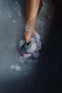 hand holding soapy sponge