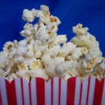 close up of red and white striped bag of popcorn
