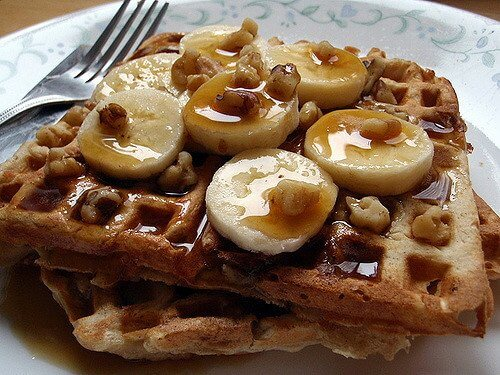 Banana waffles with walnuts, syrup and RIPE bananas.