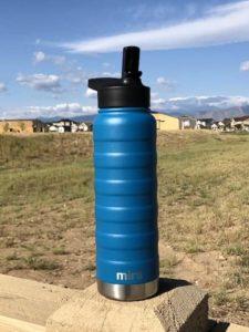 blue bottle sitting outside