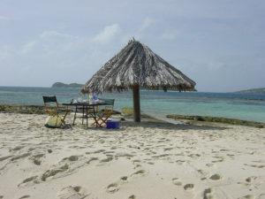 thatch umbrella on beach