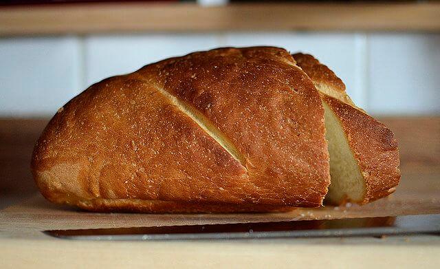 Freshly Baked and Sliced Loaf of Bread