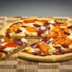 Making pizza at home is way better with a pizza stone.