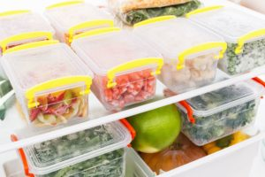 inside of refrigerator filled with food storage containers full of food