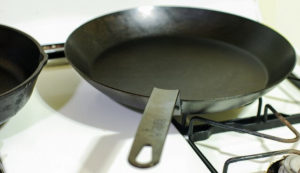 Carbon steel pans are great for the kitchen, but need to be seasoned.