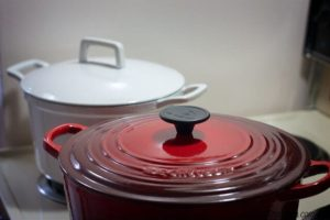 White and Red Le Creuset Cast Iron Dutch Ovens