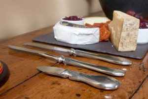 Many types of cheeses and knives