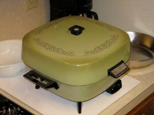 This is an electric skillet, true. But if yours looks like this, it's time to move on.