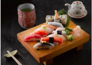 variety of Sushi on a wooden board