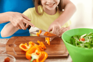 Mom and Kid Cutting Food