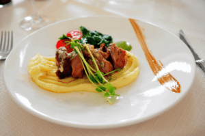 Medium rare steak with potato mash, veg and sauce