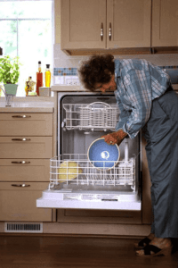 Open dishwasher with dishes