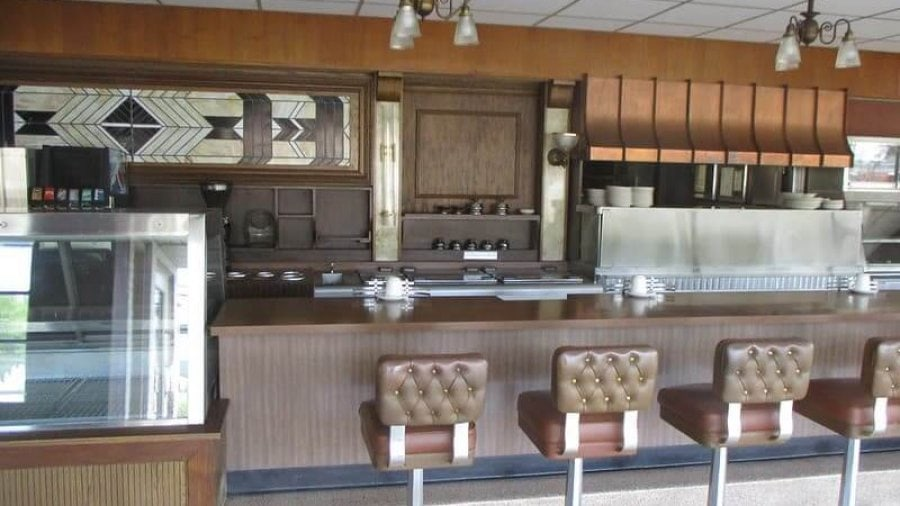 An Empty Howard Johnson Diner Counter with Barstools and Coffee Mugs
