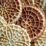 tan pizzelles with flower design