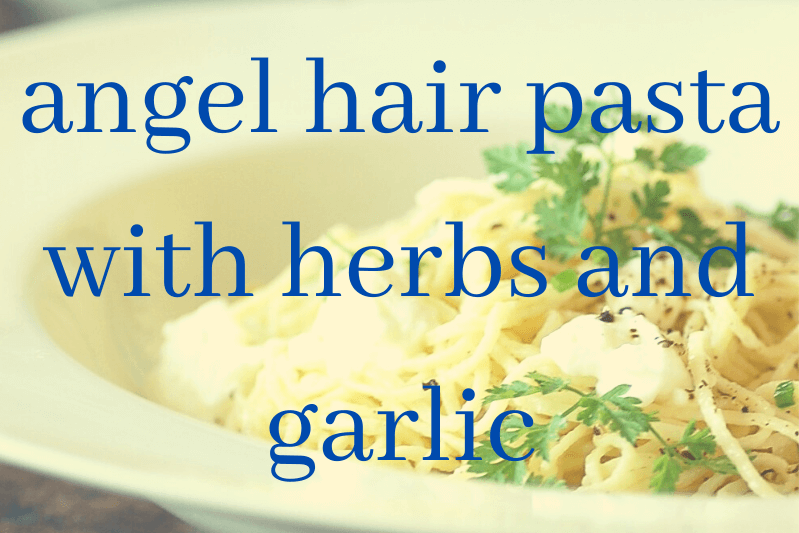 angel hair pasta in white bowl with parsley