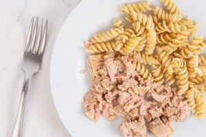 tuna and pasta on white plate with fork