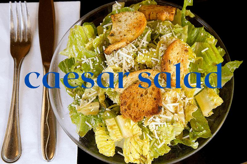 caesar salad in glass bowl