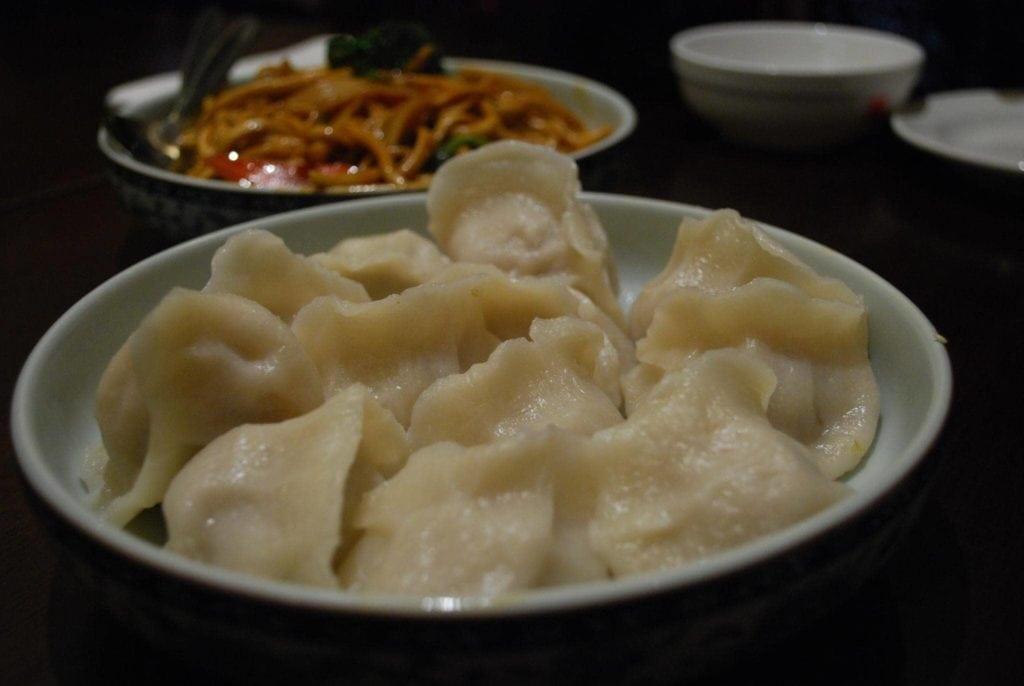 chinese pork dumplings in white bowl