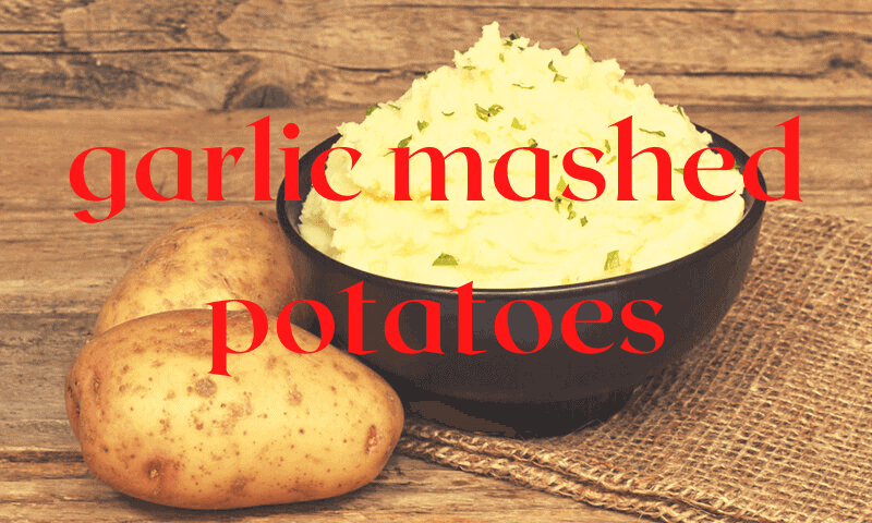 bowl of mashed potatoes with raw potatoes beside bowl