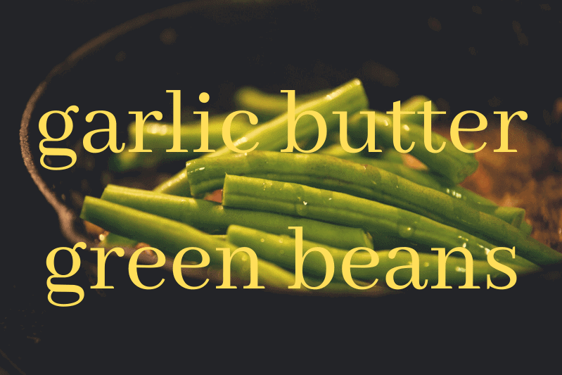 garlic butter green beans in black bowl