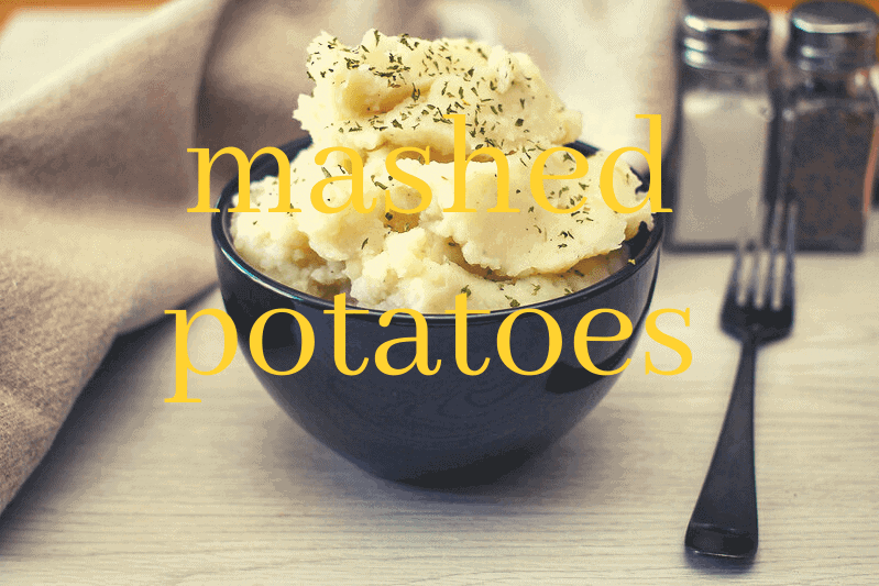 black bowl of mashed potatoes