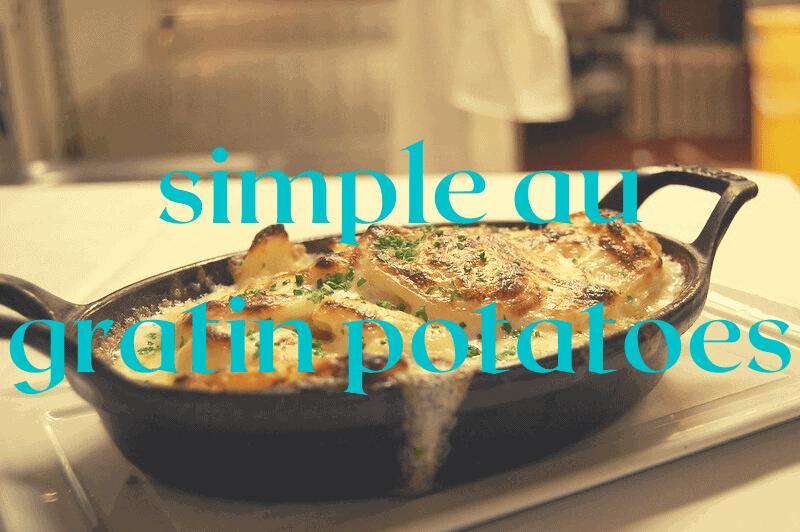 black cast iron casserole dish with au gratin potatoes
