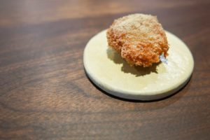 breaded fried chicken oyster on white plate on table