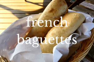 two baguettes in a lined basket