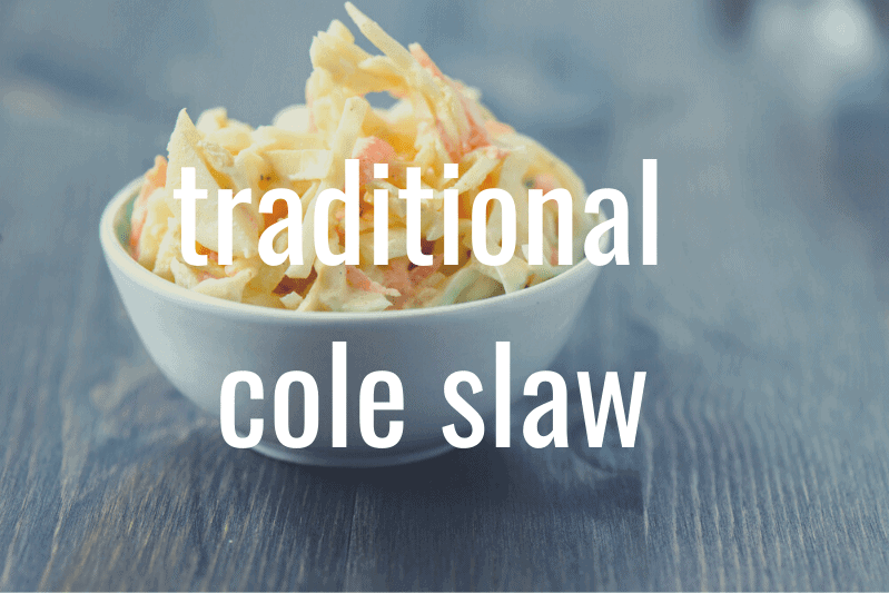 small white bowl of cole slaw on wooden table