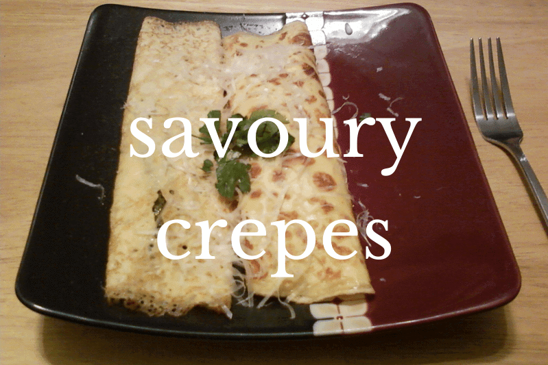 two crepes on red plate