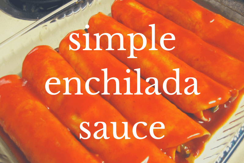 enchiladas in pan with red enchilada sauce