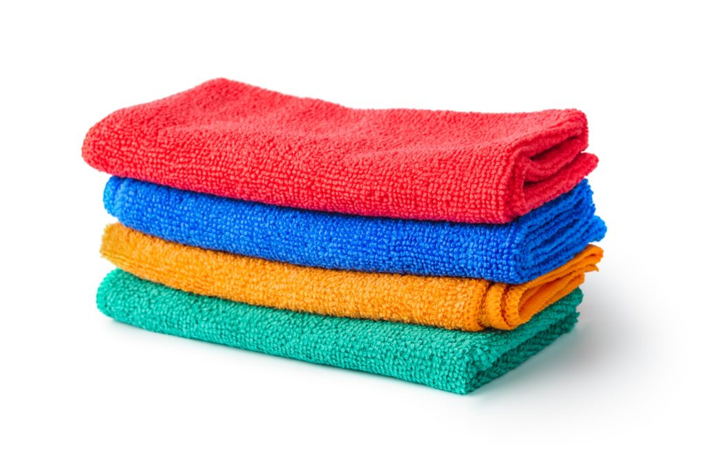 four colorful microfiber cloths on white background