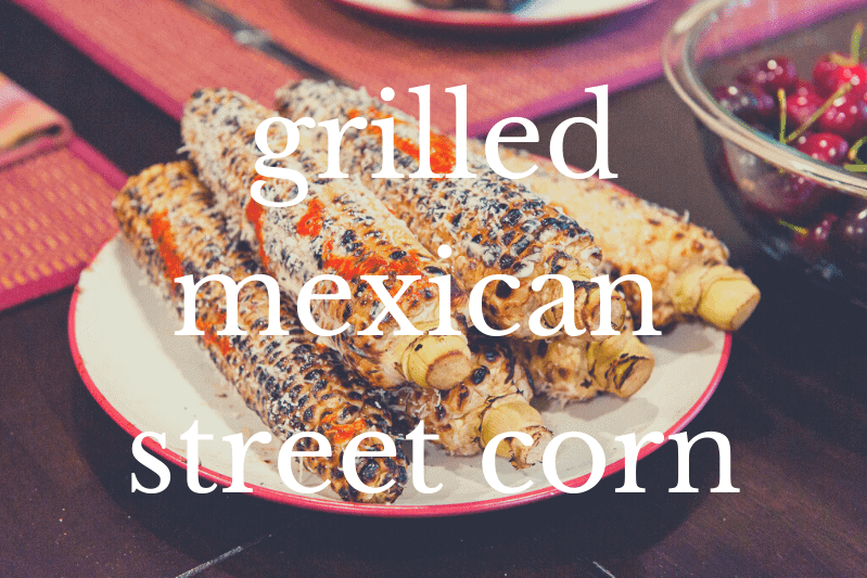 mexican street corn on white plate on table