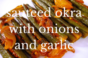 white plate of sauteed okra