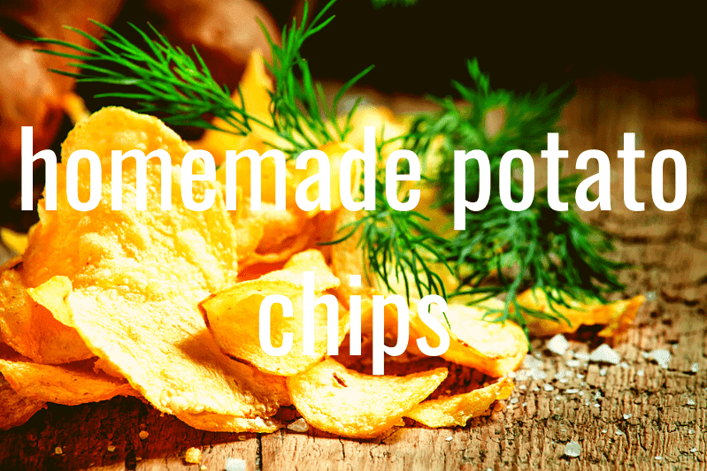 homemade potato chips with salt and dill weed on wooden cutting board