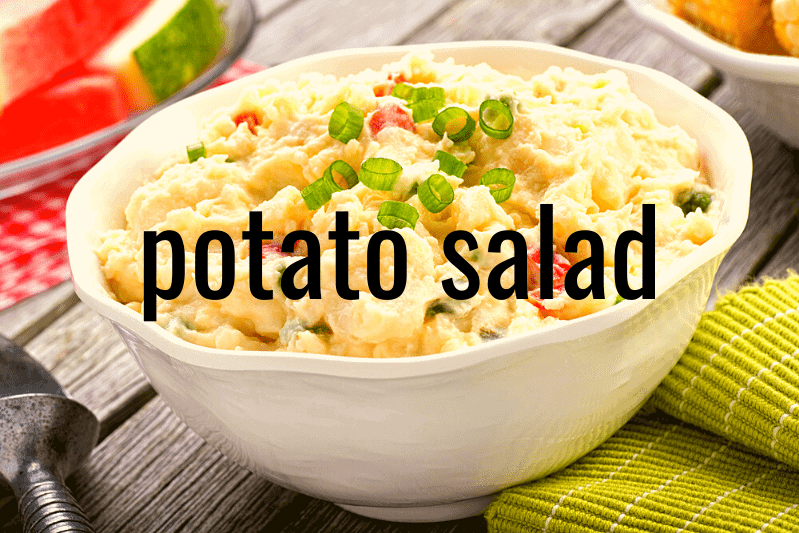 potato salad in white bowl on wooden table