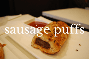 sausage puff on white dish with dip
