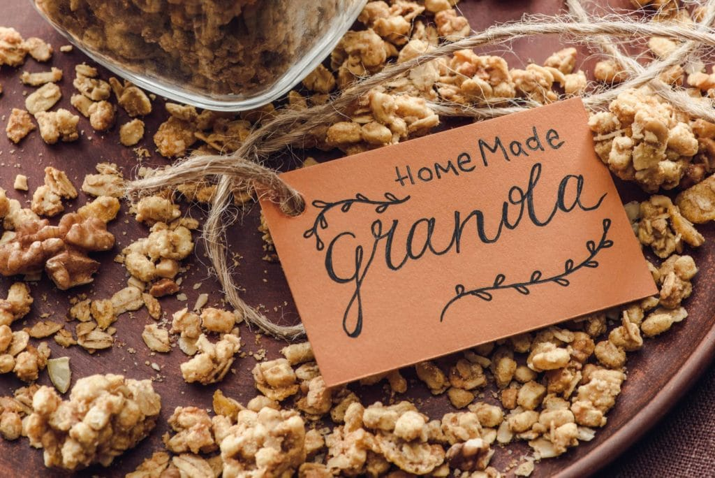 close up of granola on wood table with card that says homemade granola