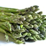 bunch of fresh asparagus on white background