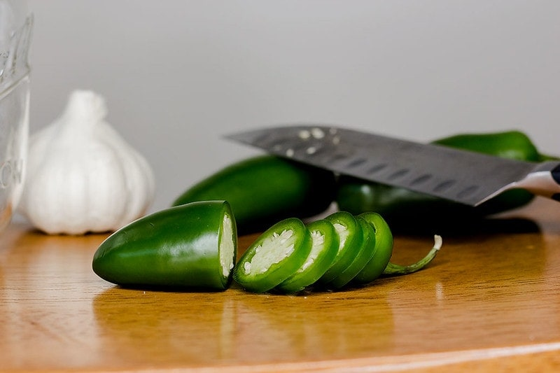 partially sliced jalapeno and knife
