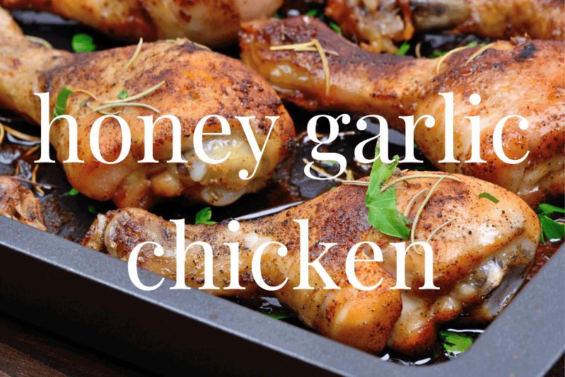 close up of honey garlic chicken legs in pan