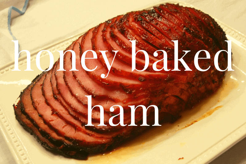 sliced honey baked ham on white platter