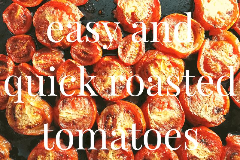halved roasted tomato on baking sheeet