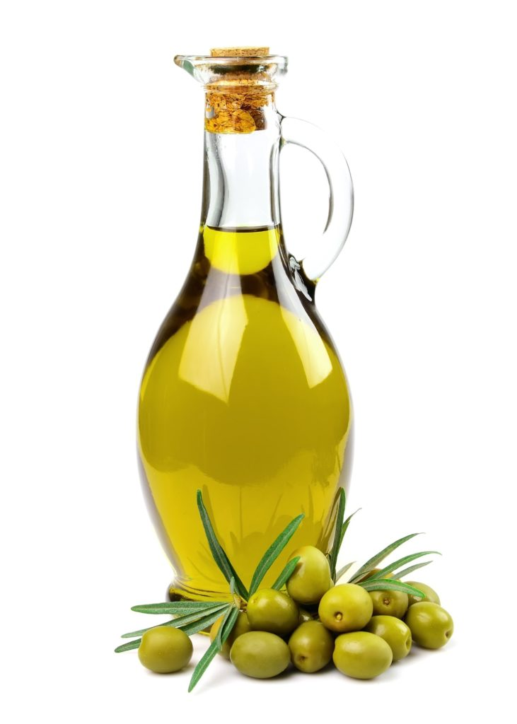 bottle of olive oil with cork and green olives