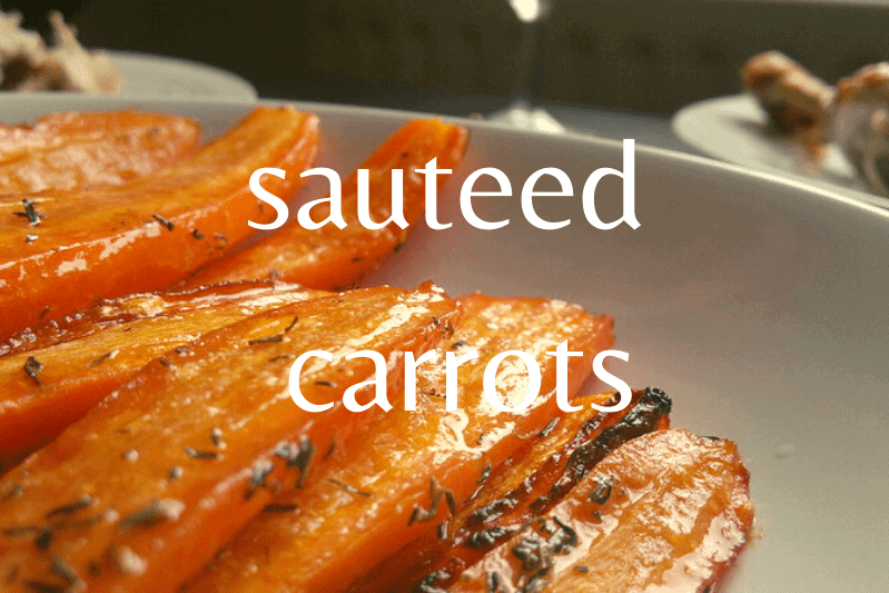 close up of sliced cooked carrots on white dish
