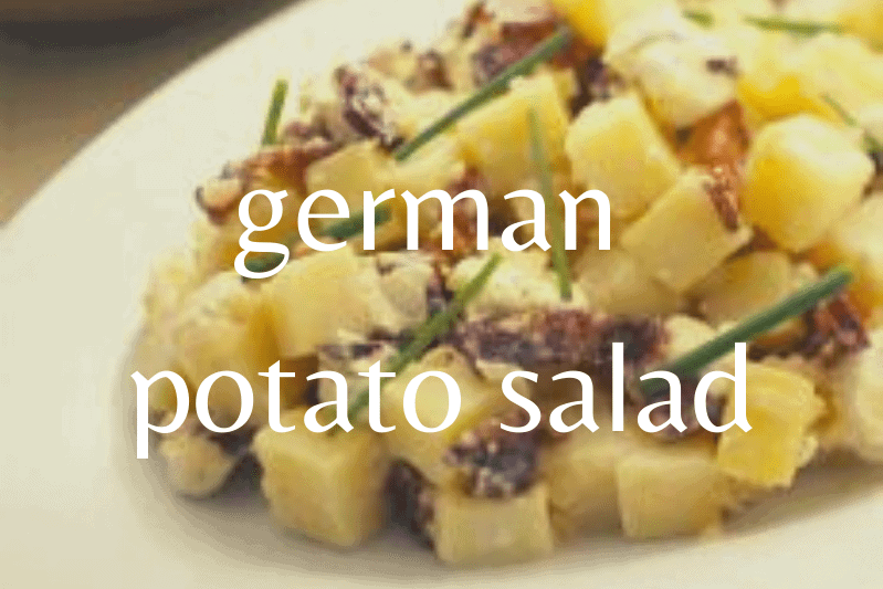 close up of german potato salad on white plate