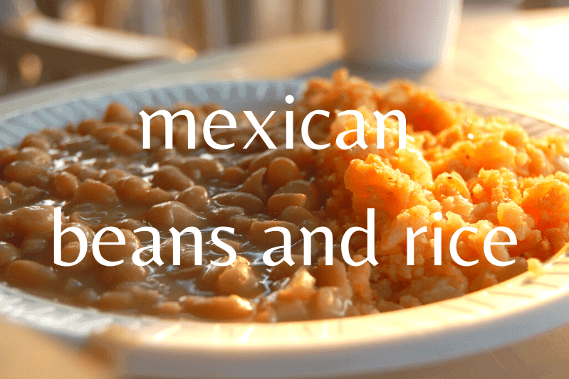 mexican rice and beans on white plate